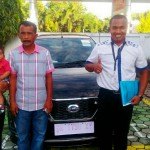 Foto Penyerahan Unit 2 Sales Marketing Mobil Dealer Datsun Farid